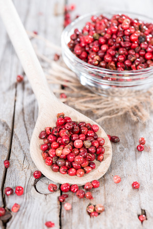 Small portion of dried Pink Peppercorns (close-up shot)