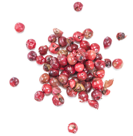 Pink Peppercorns isolated on pure white background photo