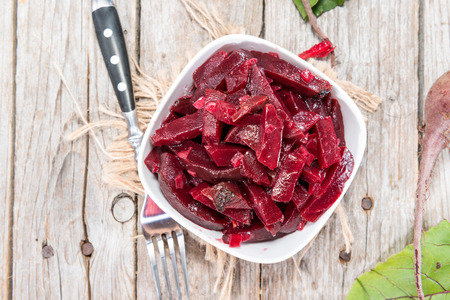 Fresh homemade Beetroot Salad with onions on wooden background photo