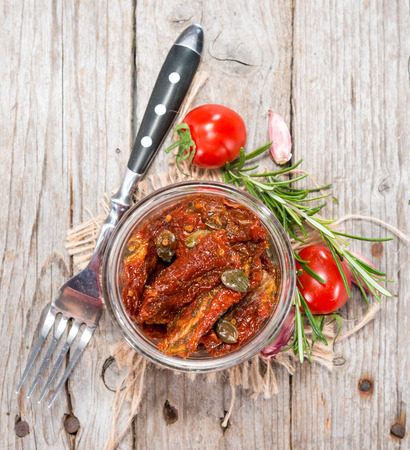 Some fresh sun dried Tomatoes with herbs and oil photo