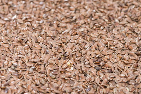 Detailed close-up shot of brown Linseeds for use as background or texture photo