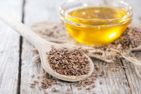 brown flax: Portion of healthy golden Linseed Oil (close-up shot) Stock Photo