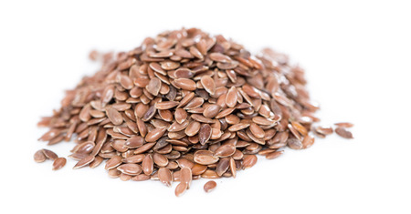 Portion of brown Linseeds isolated on pure white background photo