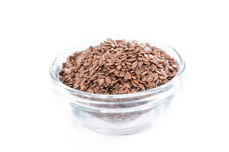 common flax: Portion of brown Linseeds isolated on pure white background