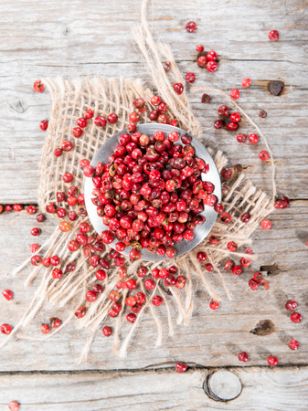 peppercorns: Small portion of dried Pink Peppercorns (close-up shot)