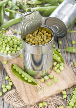 canned peas: Small portion of canned Peas with some fresh pods