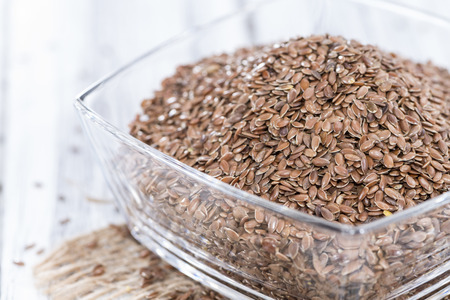 common flax: Small portion of brown Linseeds on weathered wooden background