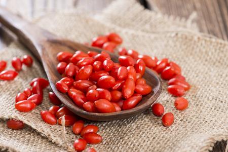 goji: Some fresh Goji Berries (also known as Wolfsberry) on vintage wooden background