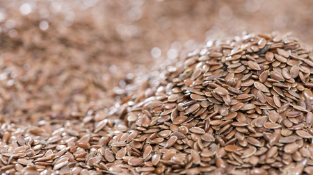common flax: Detailed close-up shot of brown Linseeds for use as background or texture Stock Photo