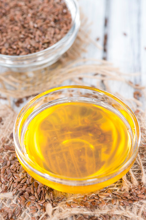 linseed oil: Portion of healthy golden Linseed Oil (close-up shot) Stock Photo