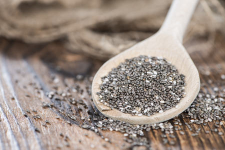chien: Chia Seeds on a wooden spoon (detailed close-up shot)
