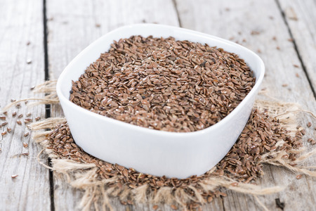 common flax: Portion of healthy brown Linseeds (detailed close-up shot)
