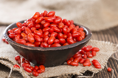 wolfberry: Some fresh Goji Berries (also known as Wolfberry) on vintage wooden background