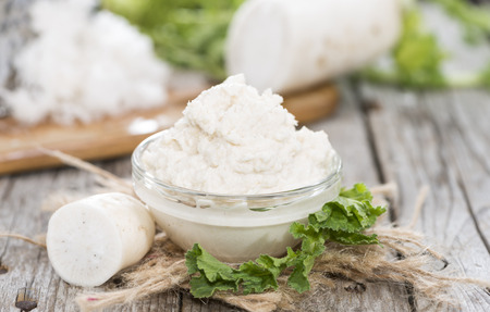 Small portion of Horseradish Sauce on wooden background Stock Photo - 30187174