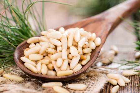 Portion of Pine Nuts as detailes close-up shot Stock Photo