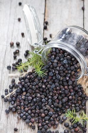 Dried Juniper Berries on wooden background (close-up shot) Standard-Bild