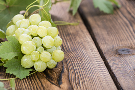 grape fruit: Portion of fresh Green Grapes on vintage wooden background Stock Photo