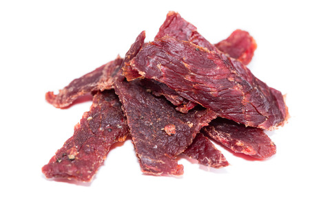 Portion of Beef Jerky (close-up shot) on pure white background Standard-Bild