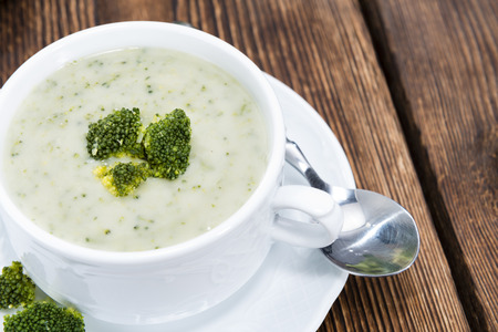 homemade: Homemade Broccoli Soup in a small bowl on wooden background
