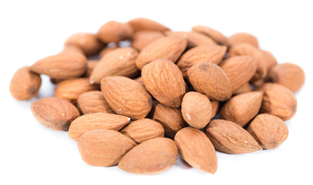 Almonds (detailed close-up shot) isolated on pure white background