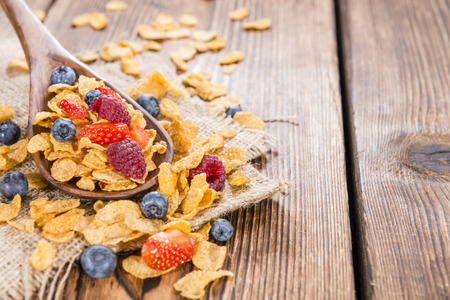 Cornflakes and different Berries (Strawberries, Blueberries and fresh Raspberries) photo