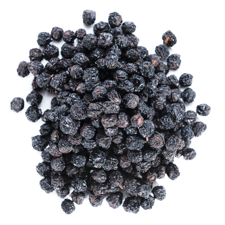 Portion of dried Chokeberries isolated on pure white background photo