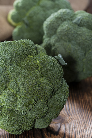 Fresh raw Broccoli as detailed close-up shot on wooden background photo