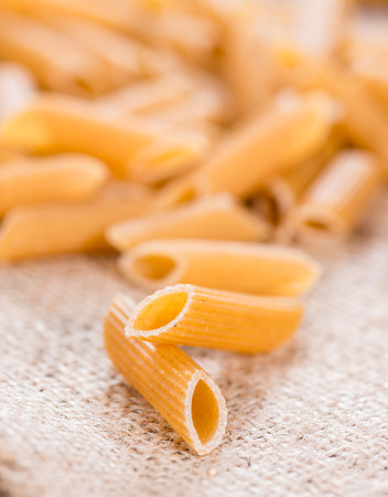 Portion of wholemeal Penne on an old vintage table photo