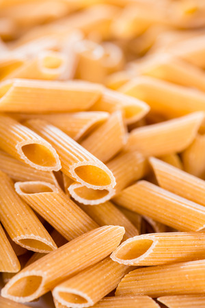 Wholemeal Pasta (Penne) for use as background image or as close-up shot photo
