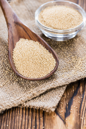 Portion of Amaranth (close-up shot) on rustic wooden background photo