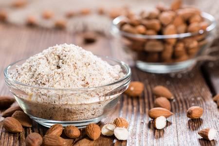 Fresh grated Almonds (detailed close-up shot) on wooden background Stock Photo