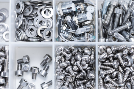 Screws and some other Machine Parts in a box photo