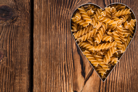 fussili: I Love Pasta concept (Wholemeal Fussili) with copyspace