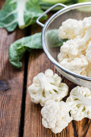 kohl: Portion of Cauliflower on dark wooden background (close-up shot)