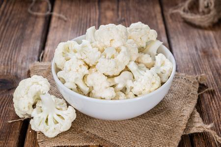 Fresh Cauliflower (close-up shot) on wooden background Stockfoto