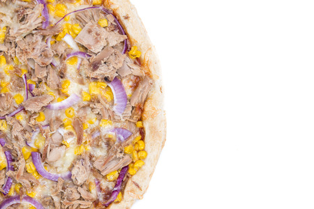 Fresh made Tuna Pizza with corn and red onions isolated on white backgroun photo