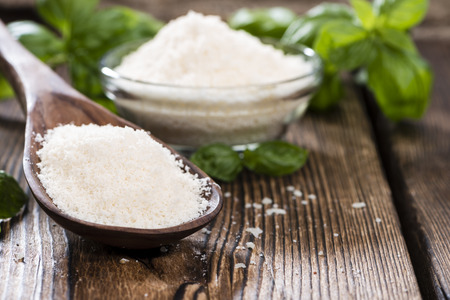 grated parmesan cheese: Portion of grated Parmesan Cheese on dark wooden background