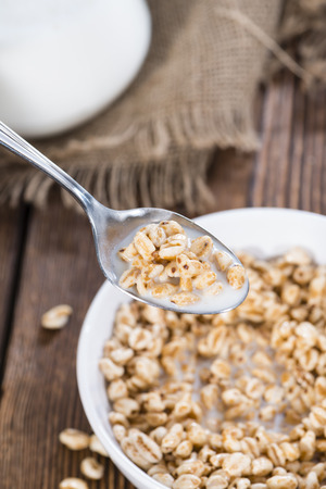 puffed: Puffed wheat with milk in a bowl (close-up shot)