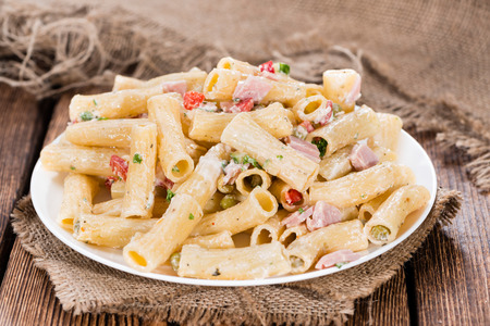 pasta salad: Pasta Salad with ham and mayonnaise on wooden background Stock Photo