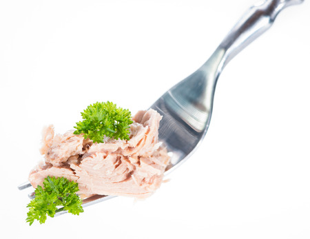 tuna fillet: Tuna with parsley on a fork (isolated on pure white background)