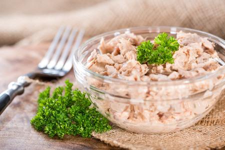 tuna salad: Fresh made Tuna Salad in a small bowl (on wooden background)