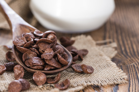 choco: Portion of sweet breakfast (choco flakes) on wooden background