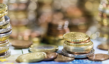 schein: European Currency stacked Coins on Banknotes (close-up shot) Stock Photo