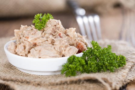 Homemade Tuna Salad in a small bowl (on wooden background)