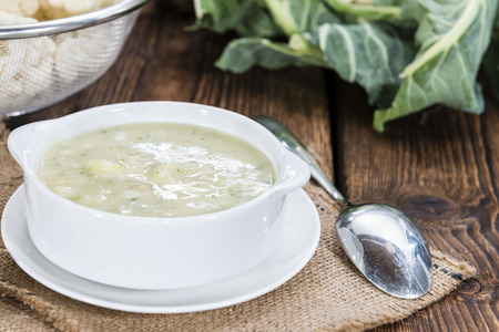 kohl: Cauliflower Soup in a small bowl (close-up shot) on wooden background Stock Photo