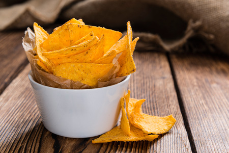 a portion: Portion of Nachos on rustic wooden background