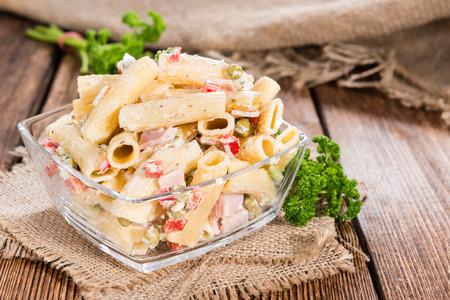 pasta salad: Pasta Salad (with mayonnaise) on wooden background (close-up shot) Stock Photo