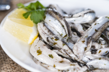 portion: Portion of Anchovis with herbs (close-up shot)