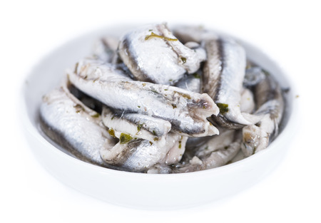 portion: Portion of pickled Anchovis (isolated on white)