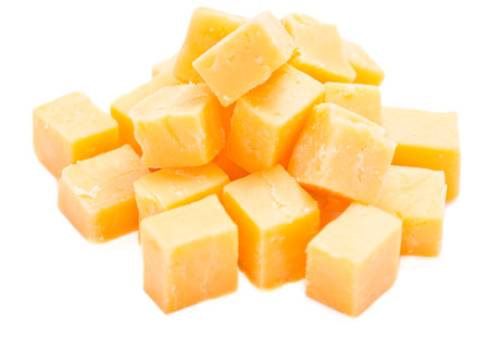 hard cheese: Diced Cheddar isolated on pure white background (close-up shot)